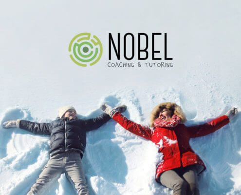 Laughing woman in a red jacket lied in the snow on the right side and on her left a boy in a black jacket is lying in the snow, making a snow angel. There is Nobel Coaching and Tutoring logo above them.