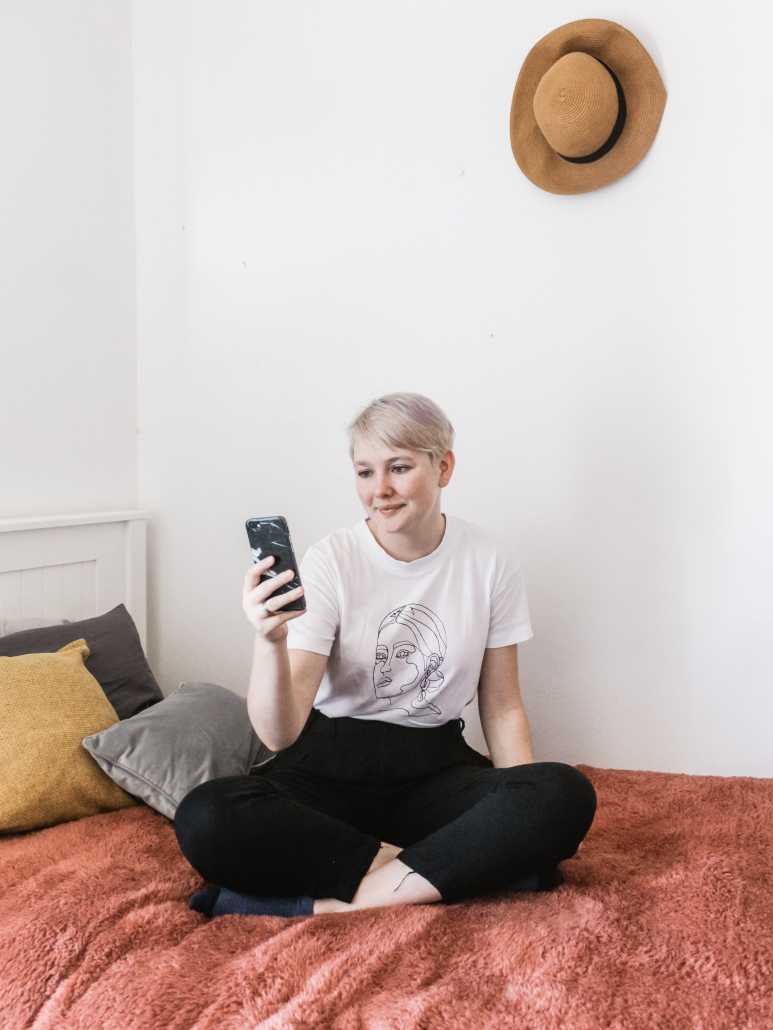 Woman sitting on a couch and holding a phone
